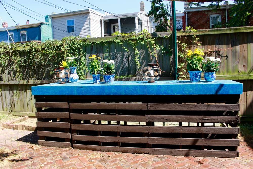 Freebird Imagery bar in backyard with potted plants