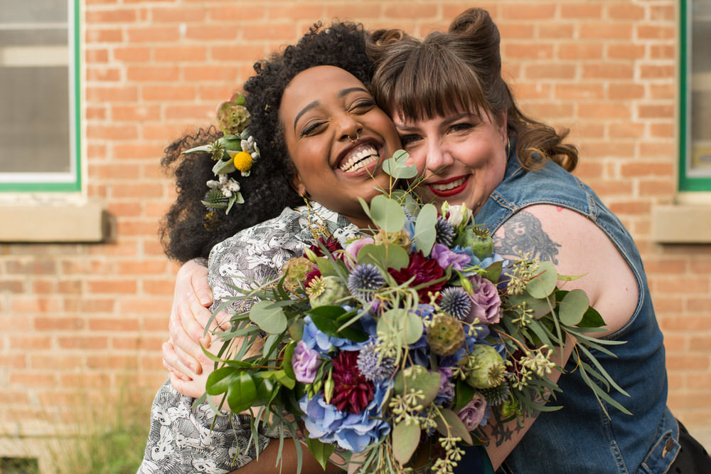 Buffy Goodman Wedding Photography brides hugging with bouquet