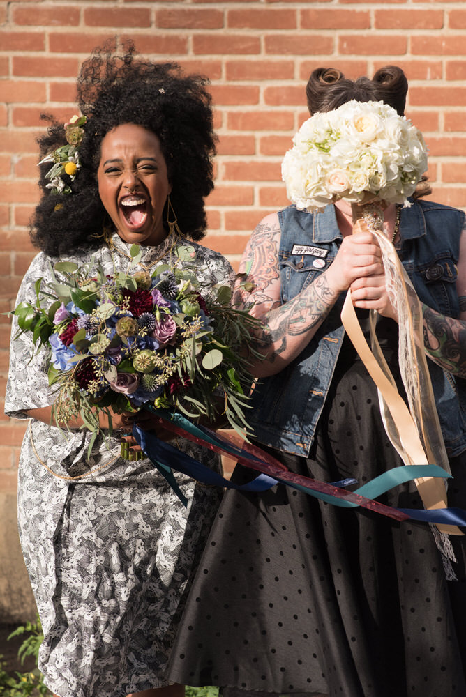 Buffy Goodman Wedding Photography brides being funny with bouquets