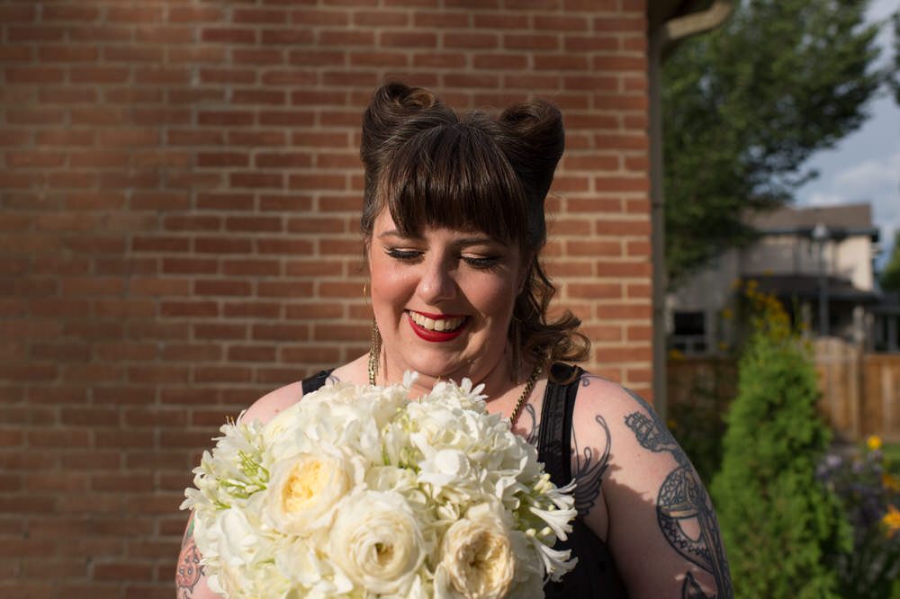 Buffy Goodman Wedding Photography bride admiring bouquet