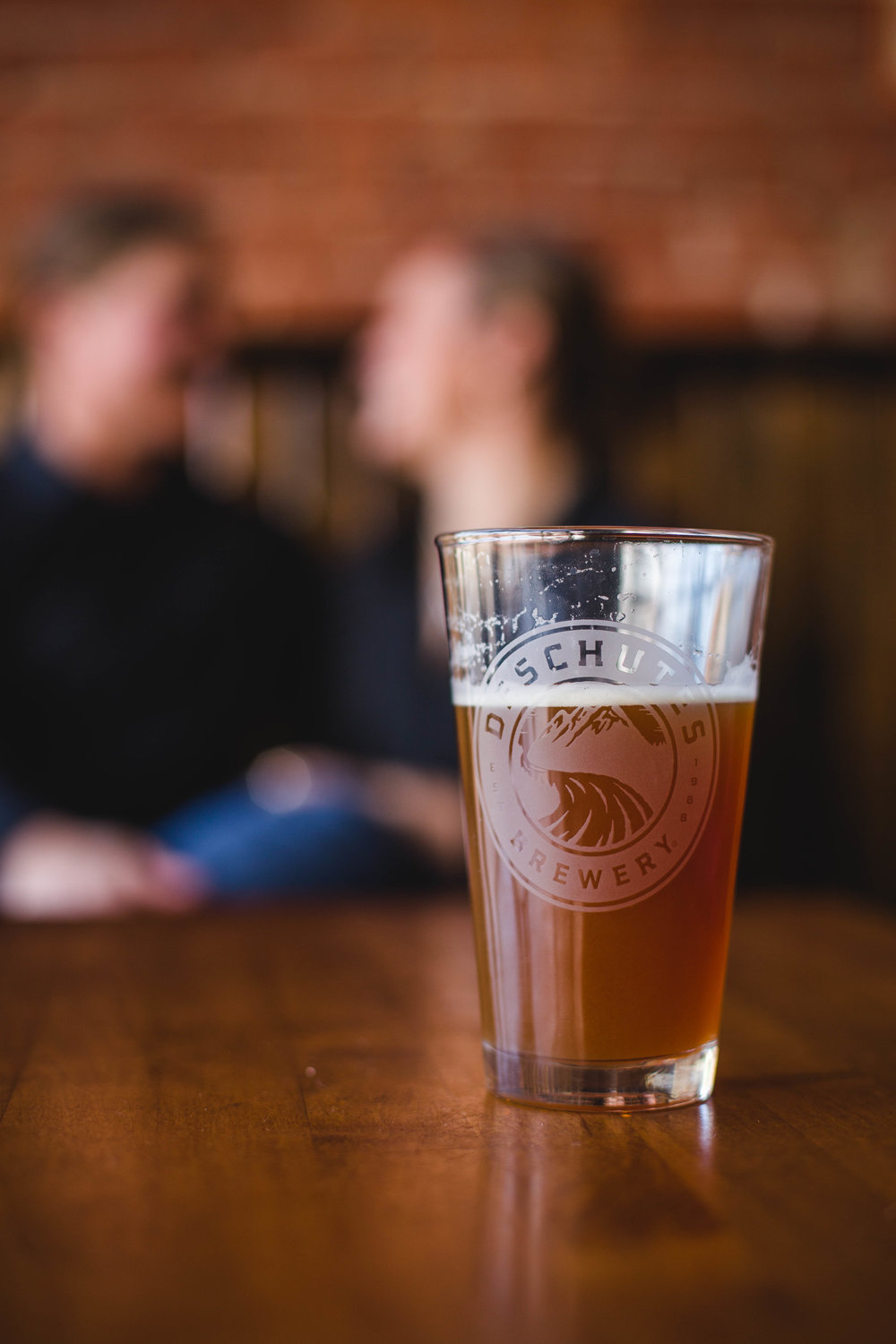 Microbrewery LGBTQ wedding engagement in Wichita Kansas by CJF Photography drinking Deschutes