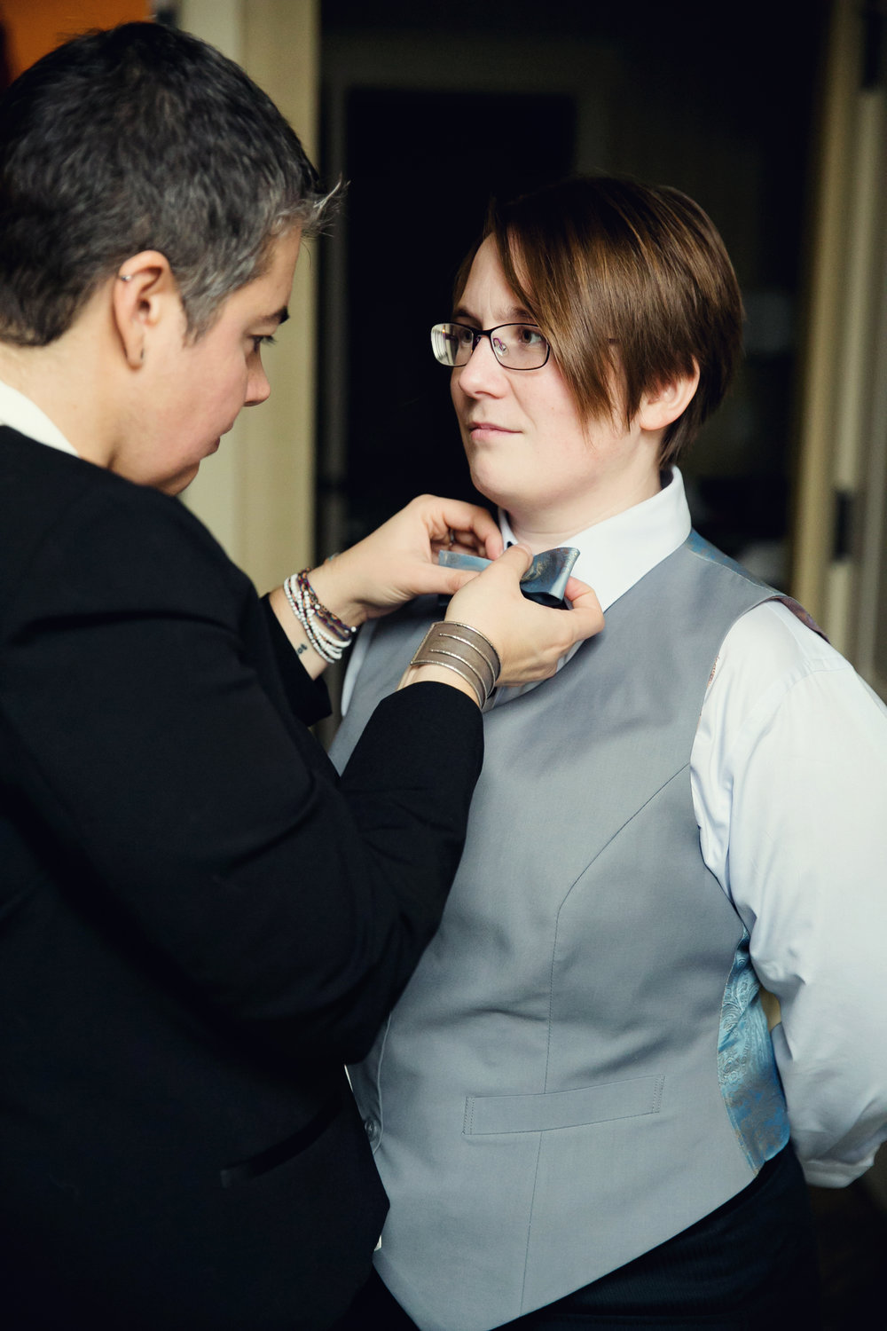 Tying bowtie for bride