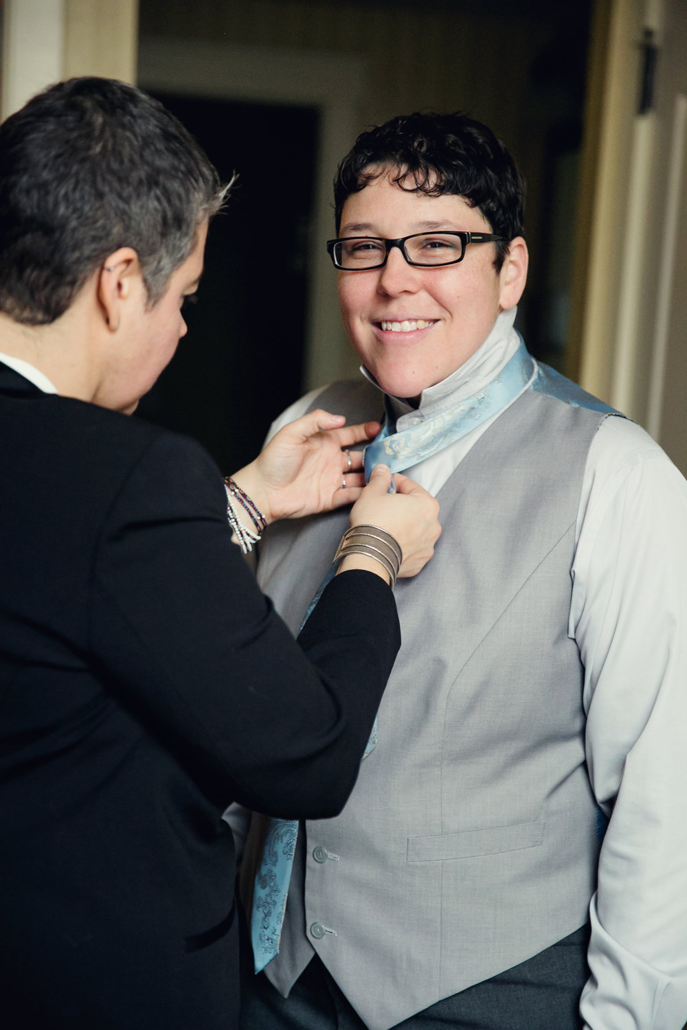 Tying a tie for bride