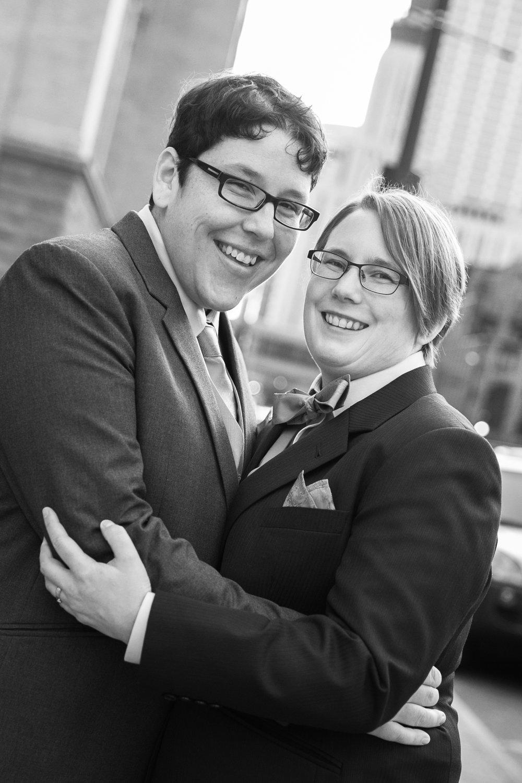 Couple gazing at camera, black and white photo