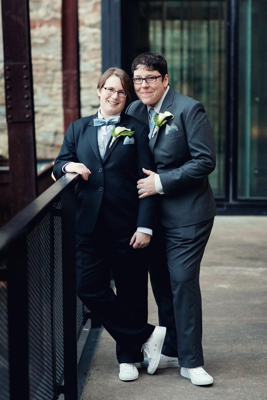Couple posing against railing
