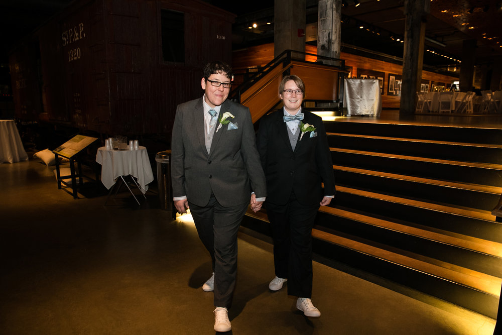 Couple holding hands at wedding venue