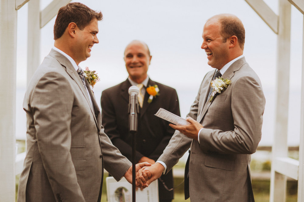 Grooms exchanging vows during their wedding ceremony
