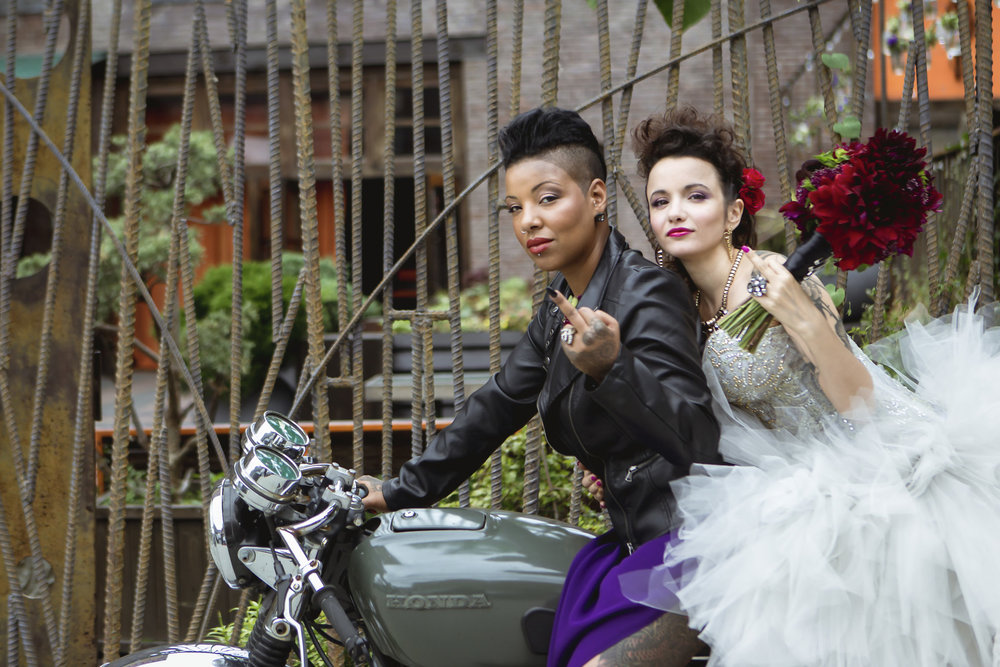 Punk rock brides on a motorcycle