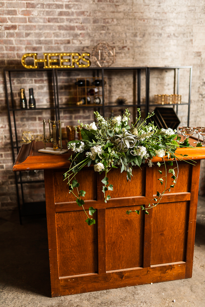 greenery and white floral bar display