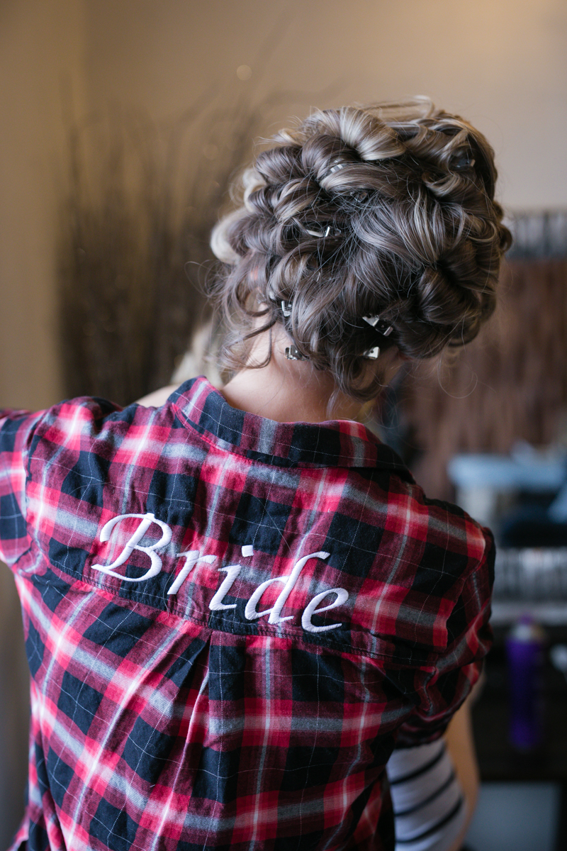 "flannel shirt embroidered with ""bride"""