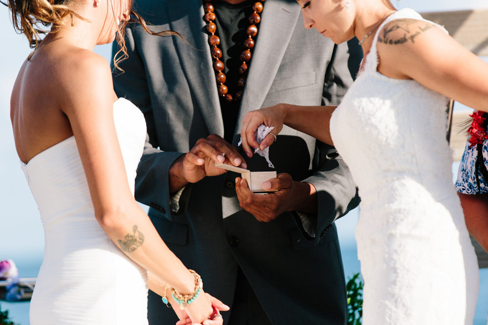 wedding ring exchange on a boat in Hawaii