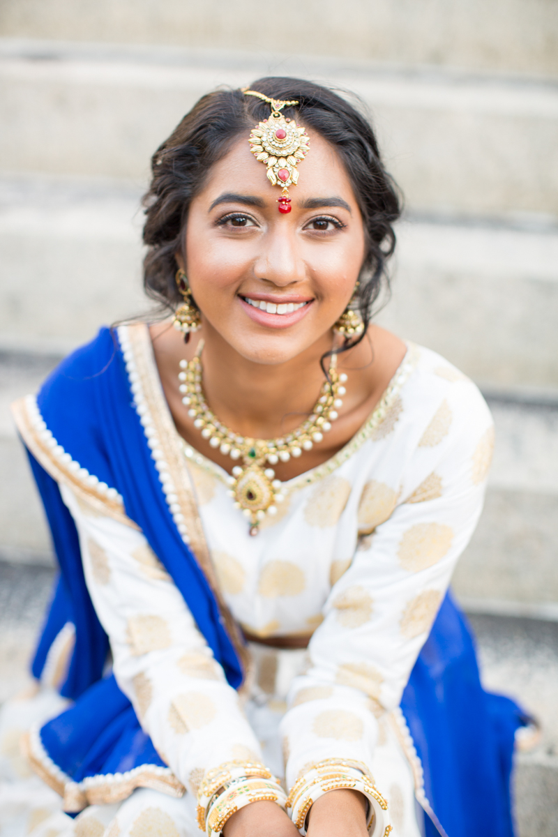 Indian bride featuring red and gold tikka