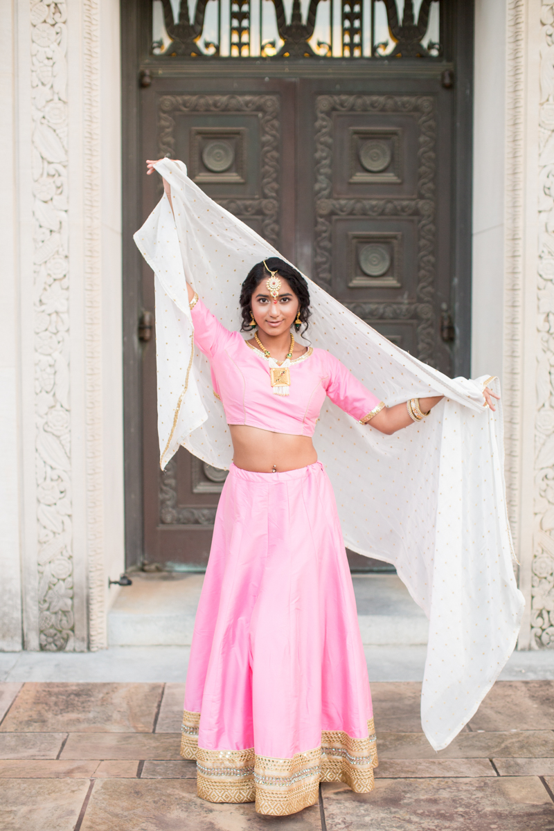 Pink, gold, and white indian bridal gown with white veil