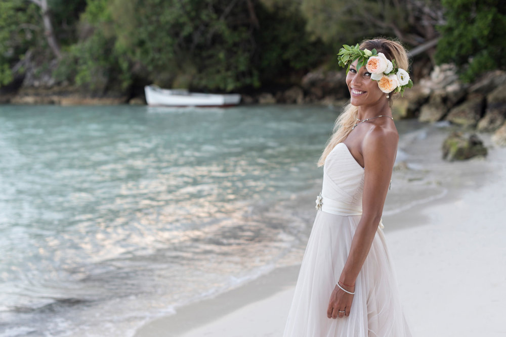Bermuda bride in flower crown on the beach