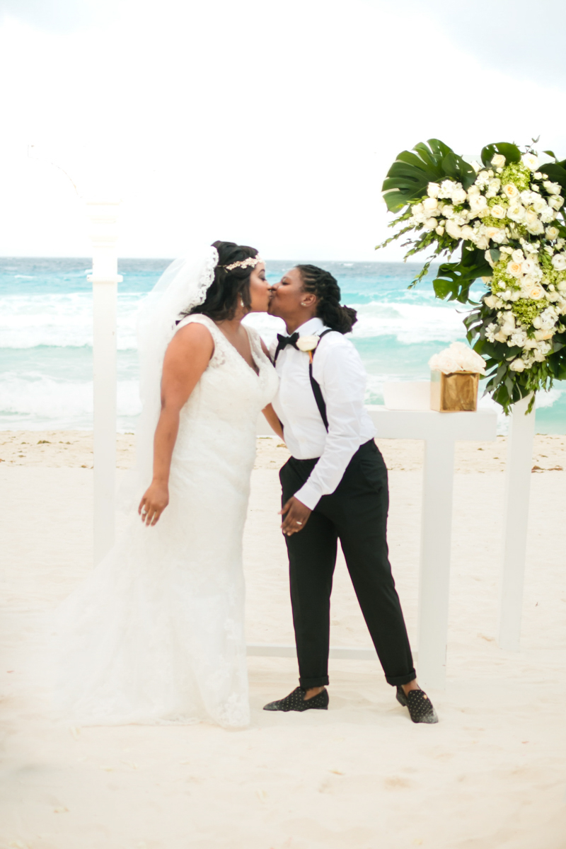 Wedding ceremony kiss on a beach in cancun