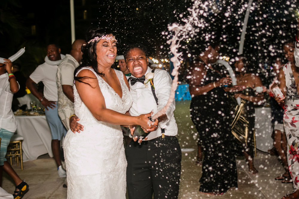 Champagne splash at lesbian wedding