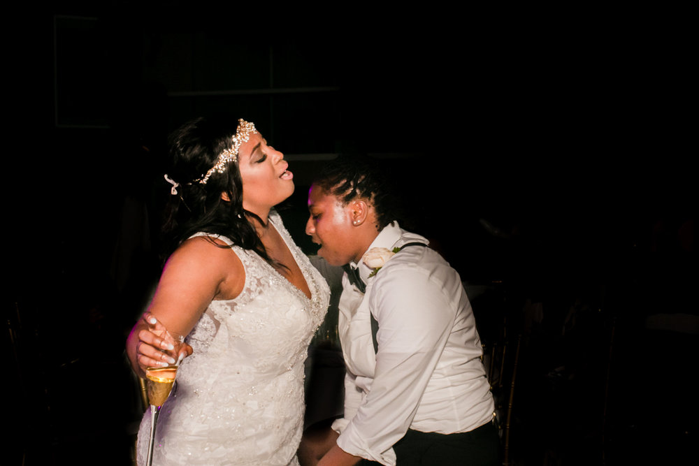 two black brides dancing at their wedding in mexico