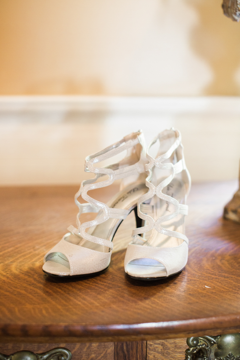 bride's shoes waiting on a dresser