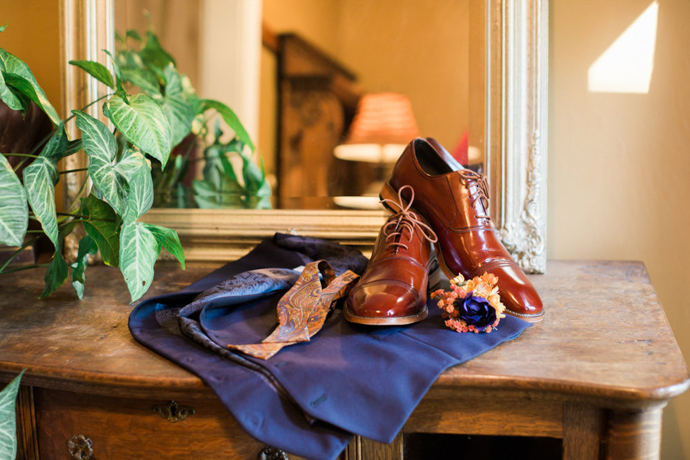 Groom's shoes on a dresser