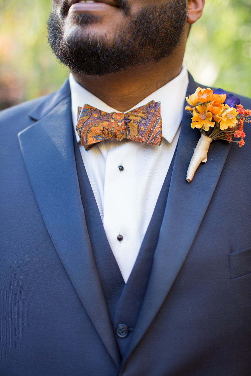 groom's orange bowtie and boutinnere details