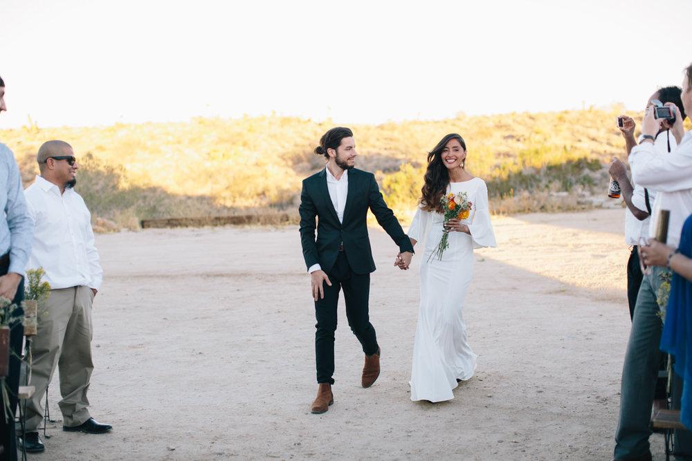 Entering the wedding ceremony together.