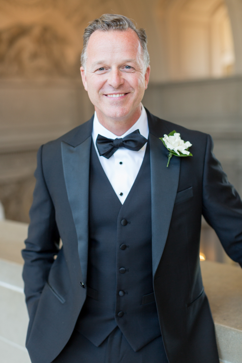 Classic groom portrait in a vest and bowtie