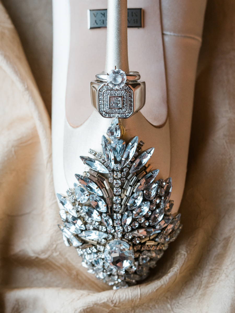 Wedding shoe with wedding ring on the heel