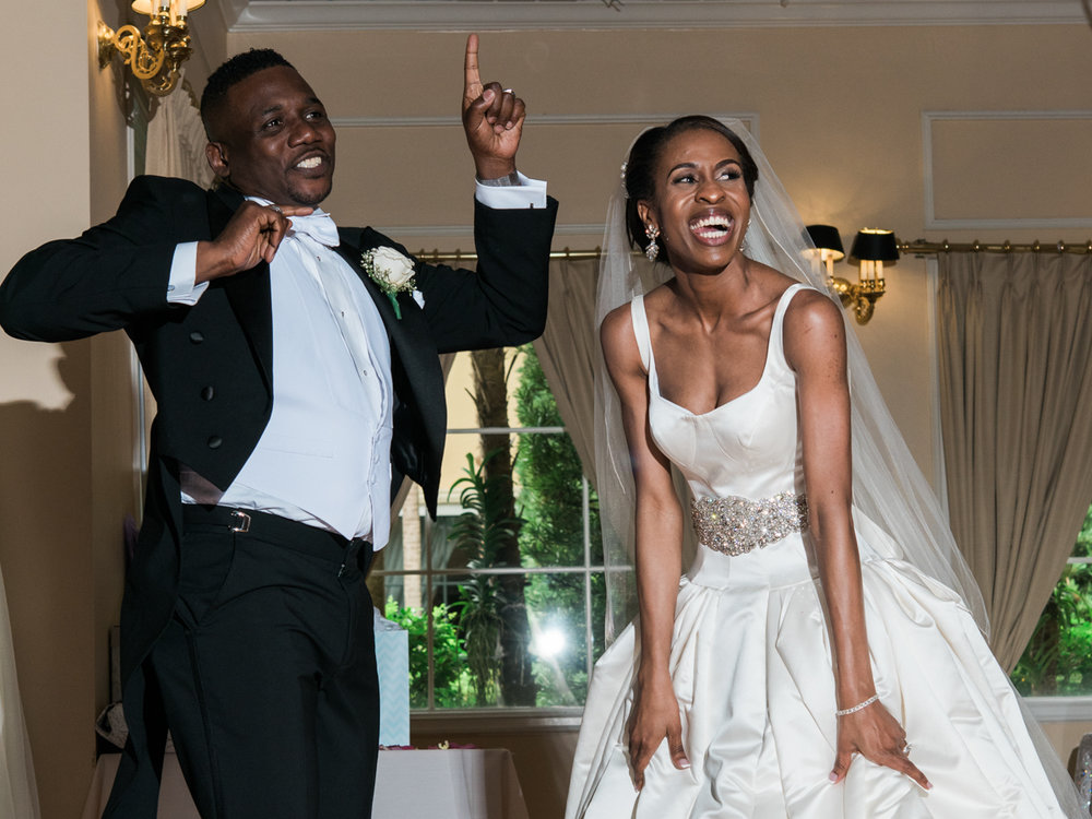 black bride and groom dancing at their reception