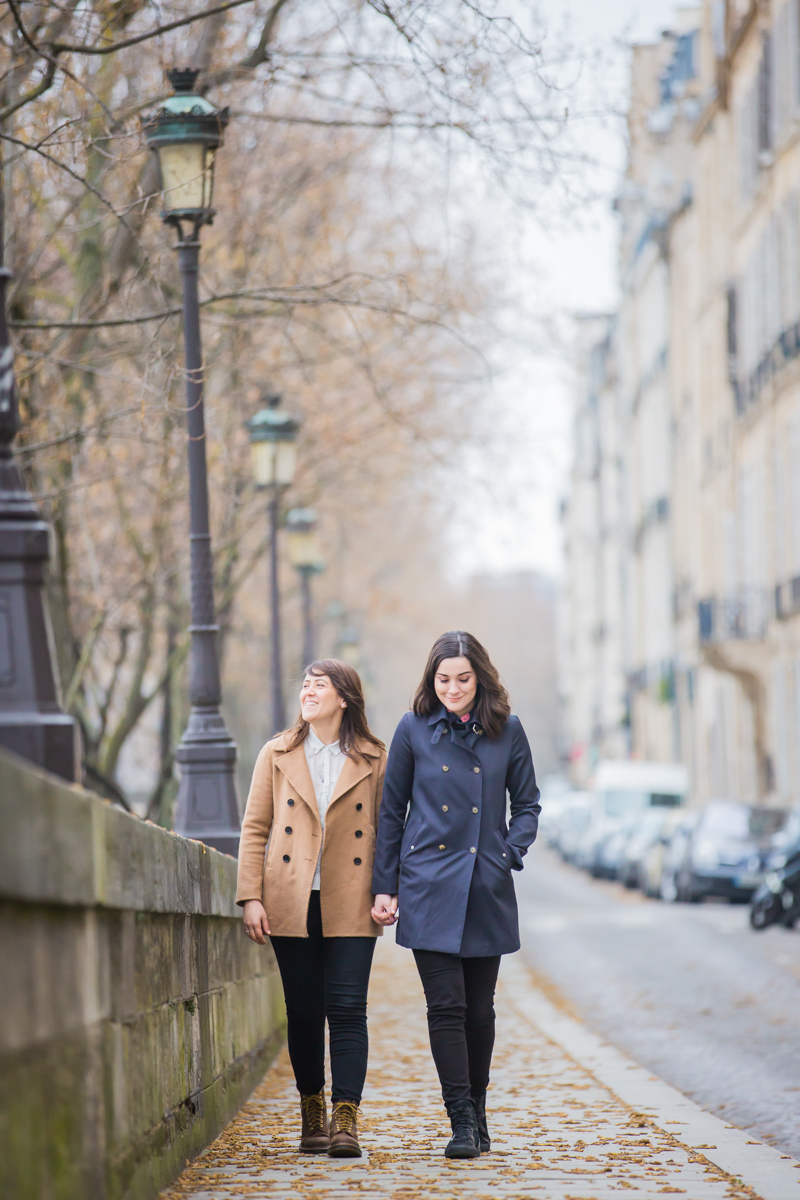 wintertime engagement photos in Paris, walking down cobblestones