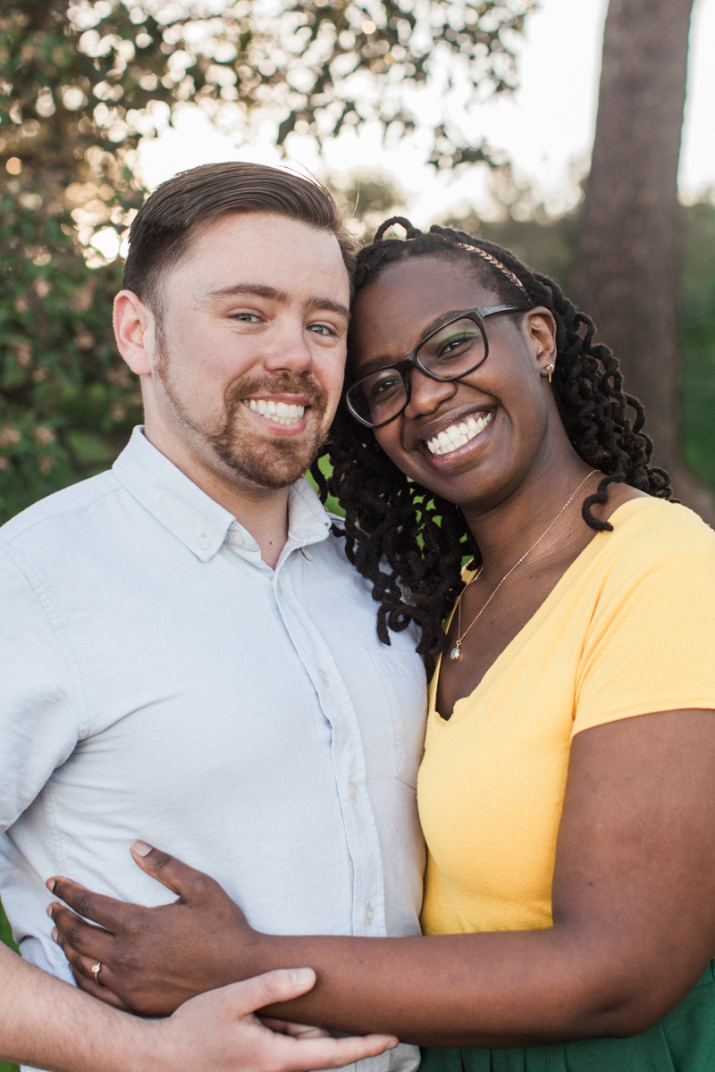 Interracial couple smiling during their engagement photos