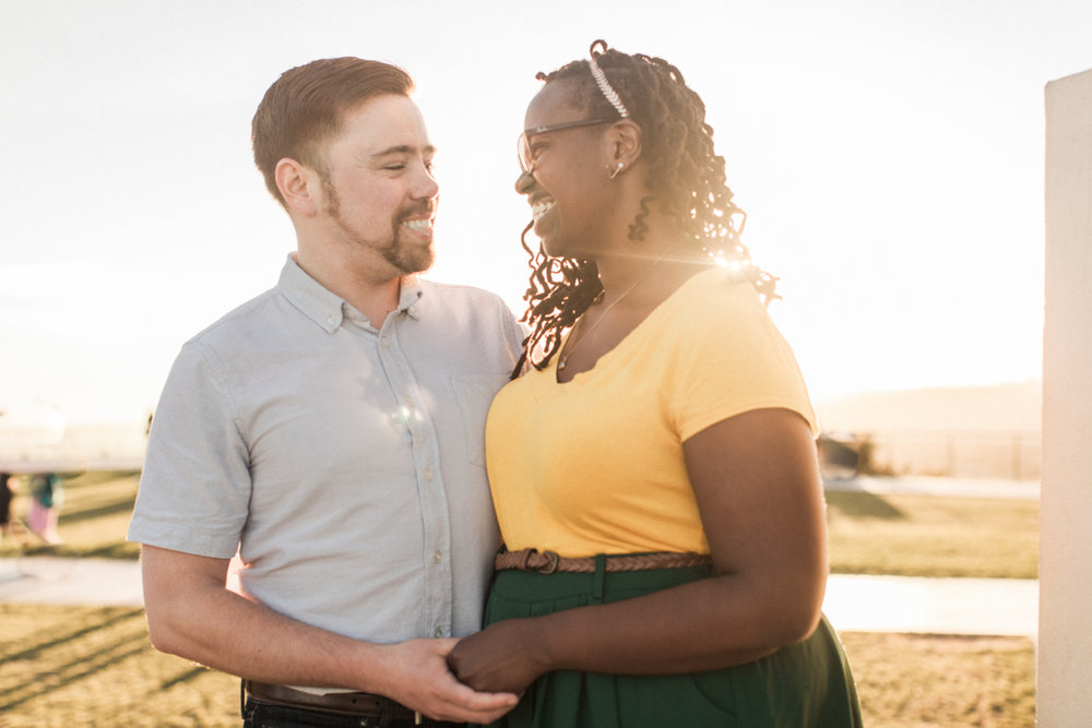 interracial couple in the sunset.