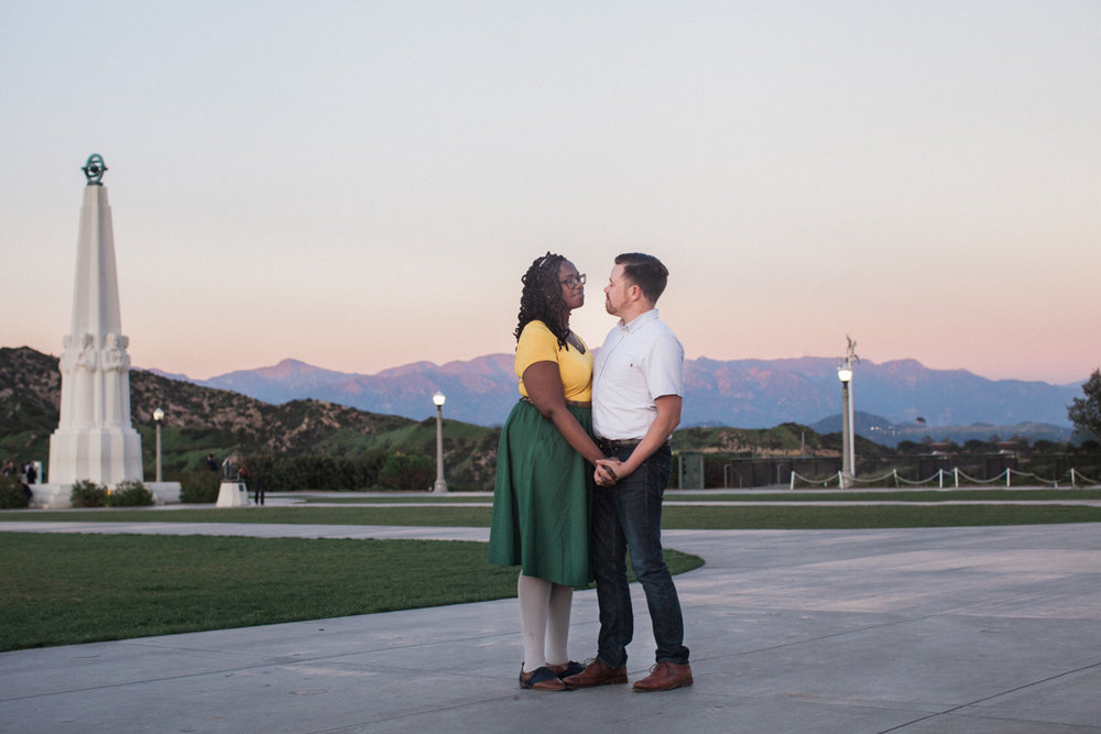 engagement photo of the couple slow dancing at the Griffith Observatory