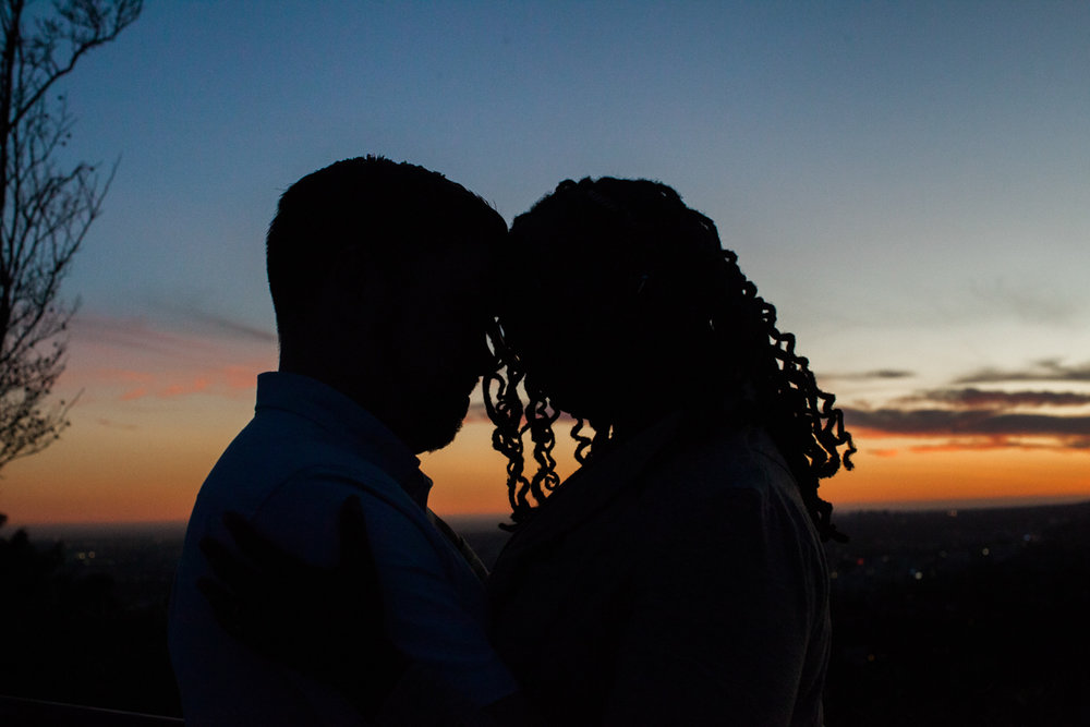 sillhouette of the couple at sunset.