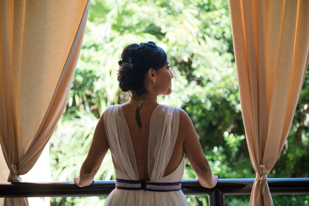 Bride in deep v-back gown