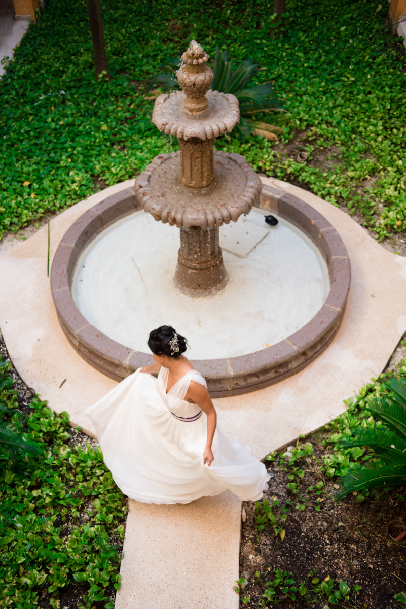 Bride in mexico photographed by a fountain, from above