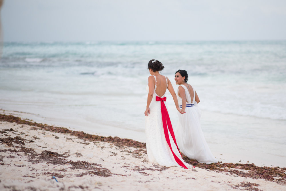 Brides on the beach at their lesbian wedding in mexico