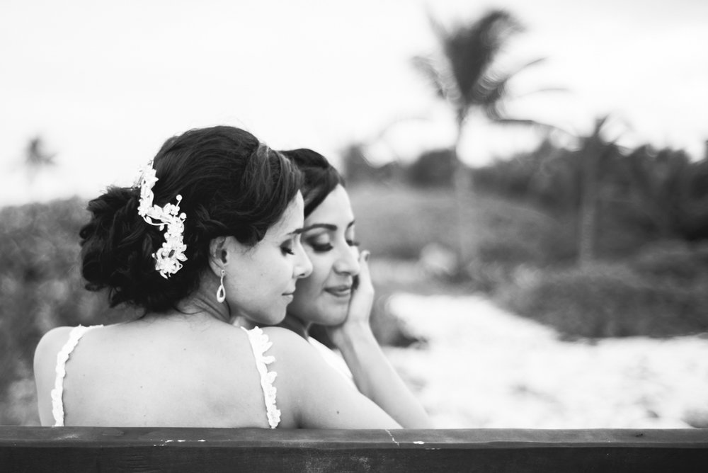 Brides at their beach weddings, snuggling