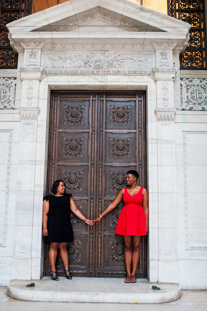Black women having engagement photos