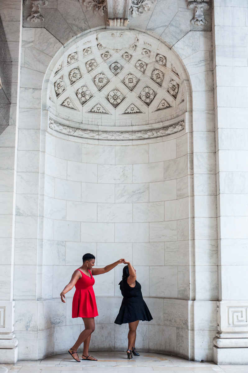twirly engagement photos in cocktail dresses