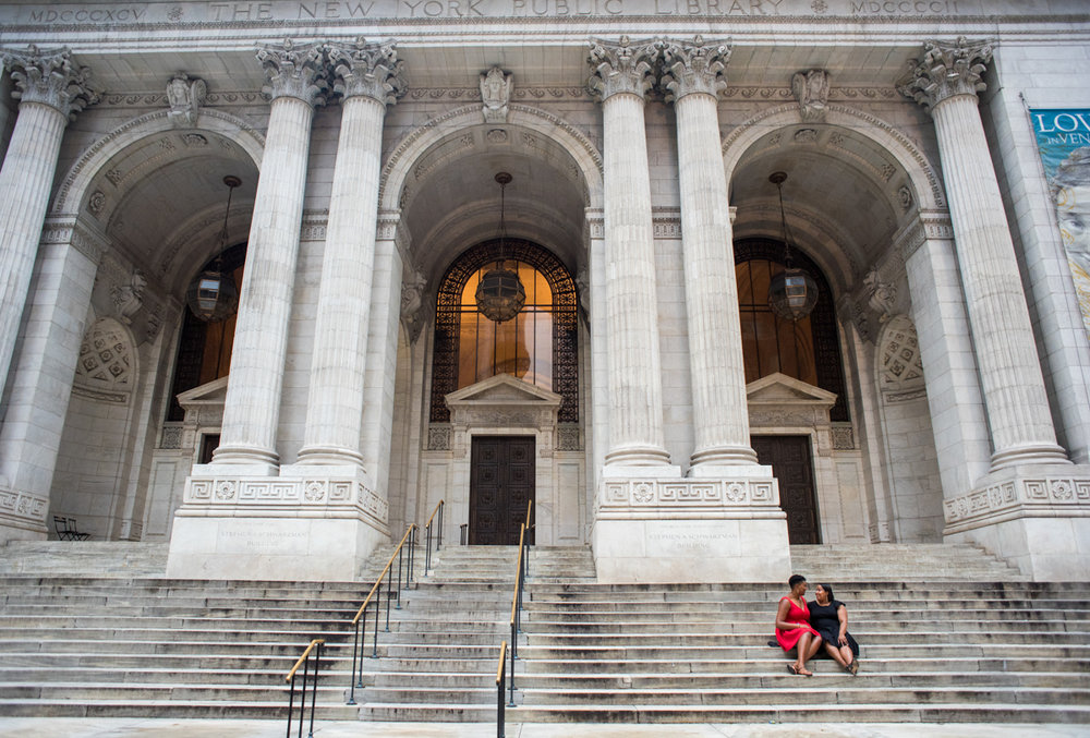 Engagement photos on the steps of a grand building in manhattan