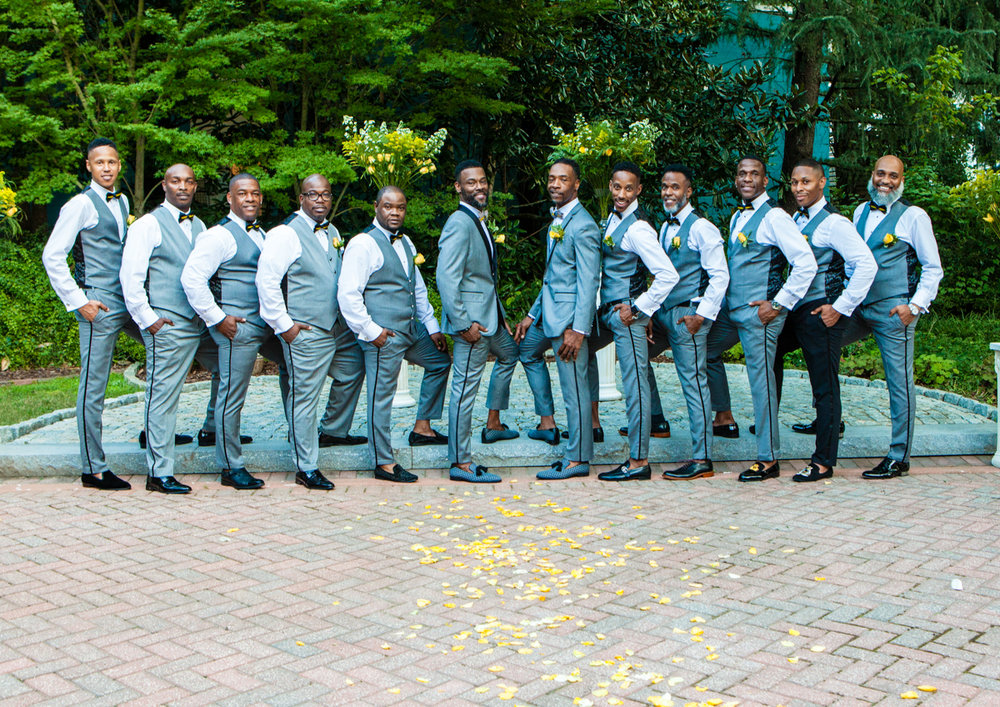 Two grooms and groomsmen in custom tuxedos by Terissa Joi