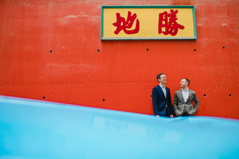 A red wall and blue car in Hong Kong engagement photos