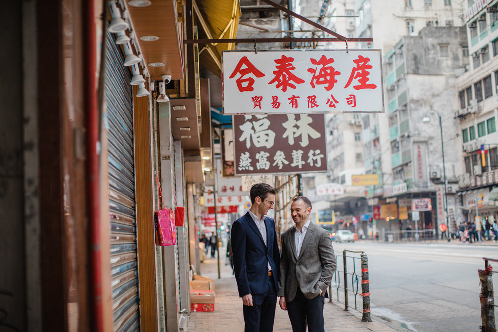 street signs in Hong Kong form a backdrop for engagement photos