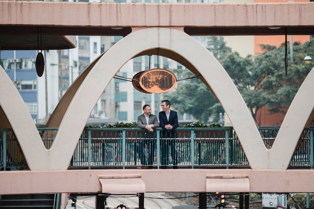 couple on a train arch in Hong Kong