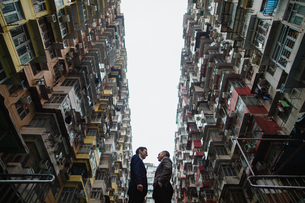 apartment buildings of Hong Kong with the couple centered