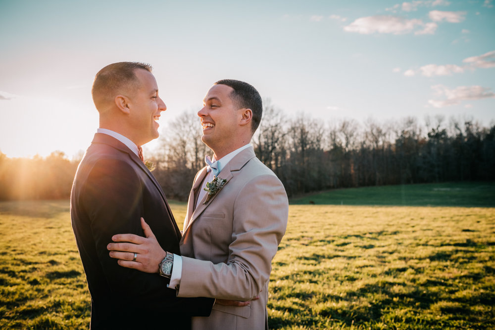 grooms getting married in the North Carolina sunset