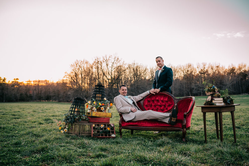 Grooms posed on styled pieces, planned by Emily Katherine Events