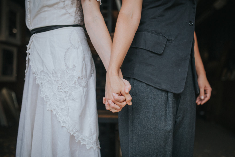 lesbian engagement photos, detail of them holding hands