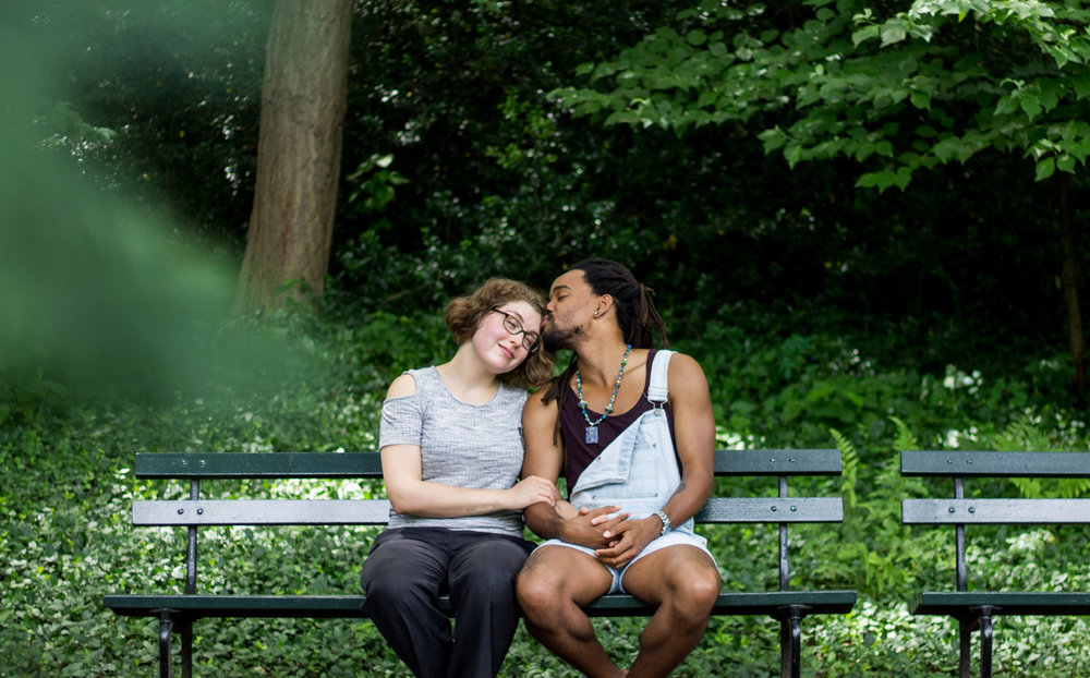 Interracial queer couple on a park bench in NYC