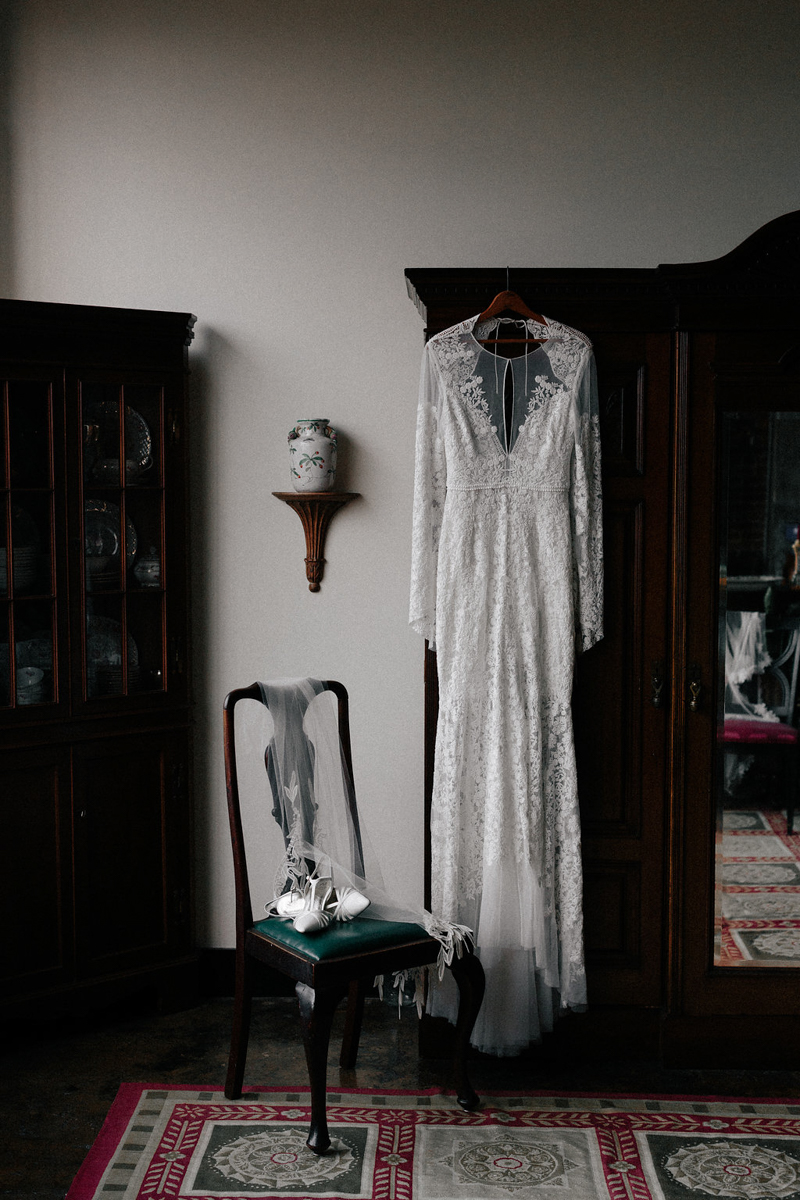 lace gown hanging from a wooden wardrobe